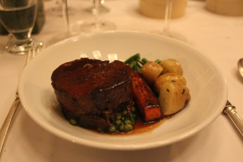 onfit shoulder of lamb with white beans, braised carrot potatos and greens