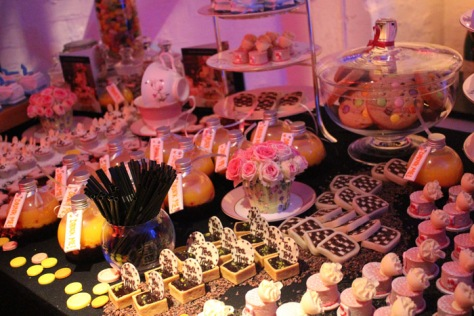 A tray of Mad hatter cakes and sweets