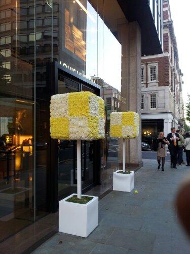 Flowers outside Louis Vuitton